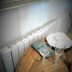 Cali sense smart electric radiators, wooden table with glasses on