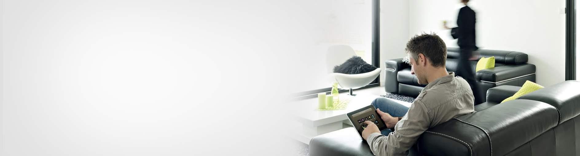 INTELLI HEAT Man on sofa using APP